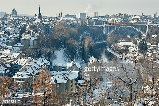 High angle view of city and river Aare with snow covered rooftops, Berne, Switzerland