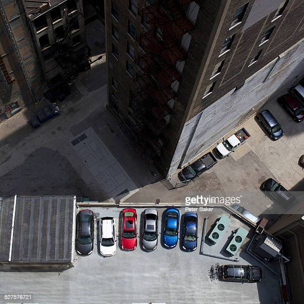 High angle view of city buildings and parked cars