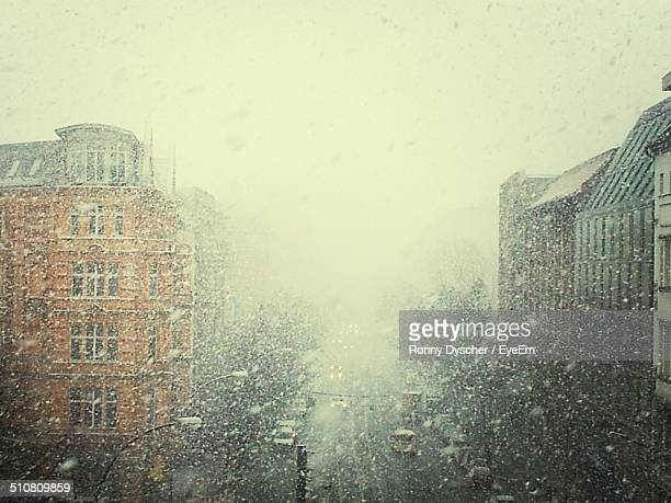 High angle view of city during snowstorm