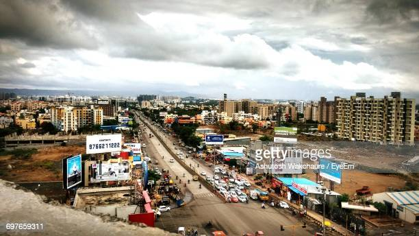 High Angle View Of City Street Against Cloudy Sky