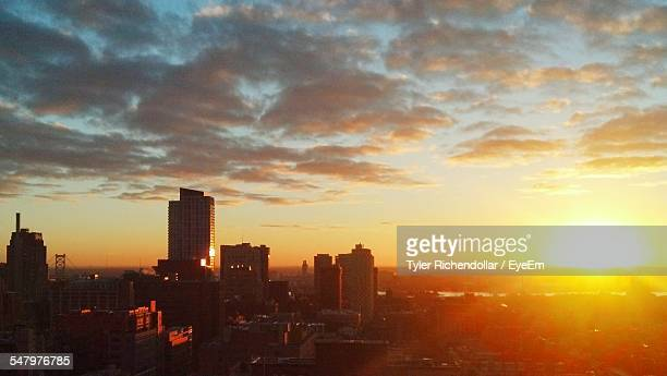 High Angle View Of Cityscape Against Cloudy Sky During Sunrise