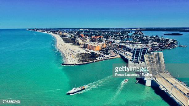 High Angle View Of Cityscape Amidst Sea Against Clear Blue Sky