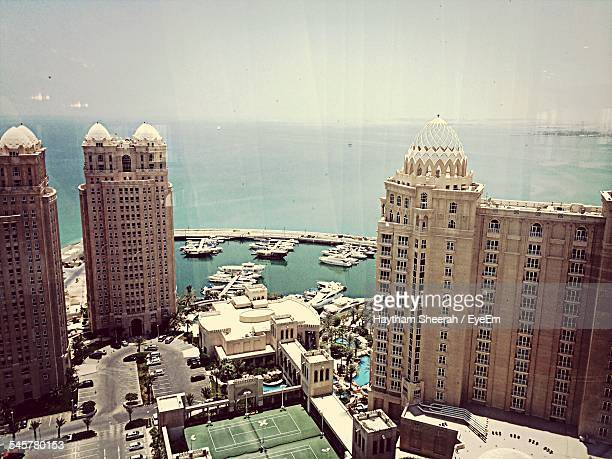 High Angle View Of Cityscape And Sea Against Clear Sky