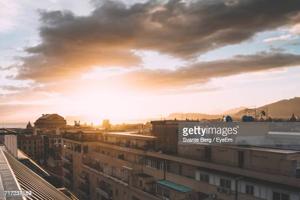 High Angle View Of Cityscape At Sunrise