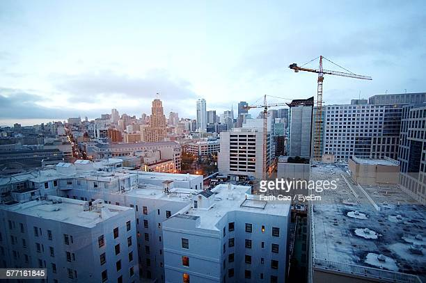 High Angle View Of Cityscape Seen Through Window Glass