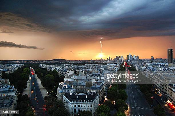 High Angle View Of Cityscape With Thunderstorm