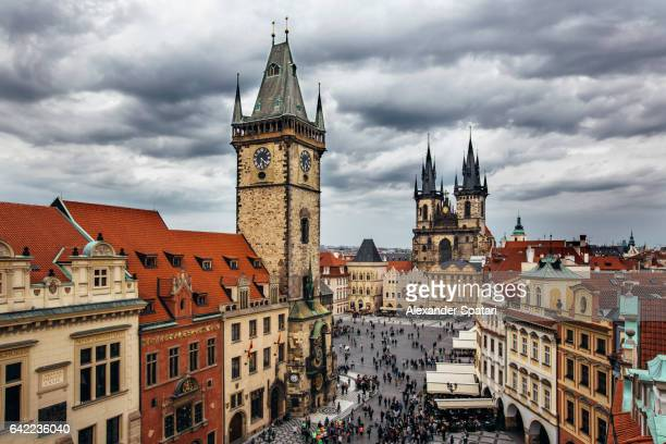 High angle view of Clock Tower, Old Town Square and Tyn Church on a clody gloomy day, Prague, Czech Republic