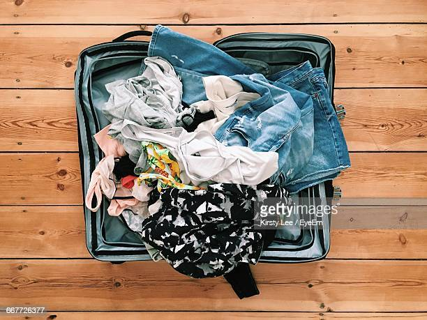 High Angle View Of Clothes In Suitcase