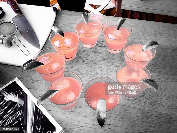 High Angle View Of Cocktails In Glasses Arranged Circle Shape On Table