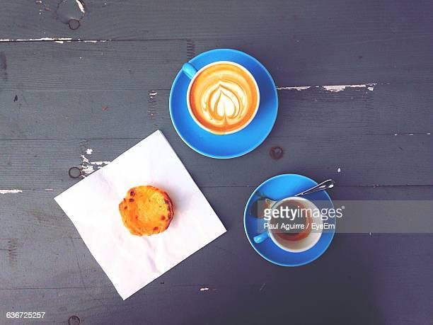 High Angle View Of Coffee And Dessert On Table