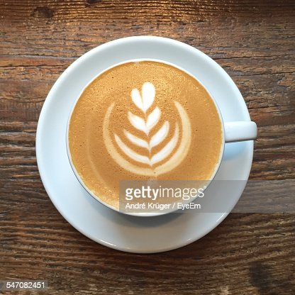 High Angle View Of Coffee Cup On Wooden Table