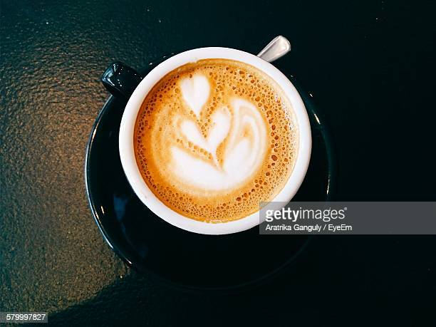 High Angle View Of Coffee In Cup On Table
