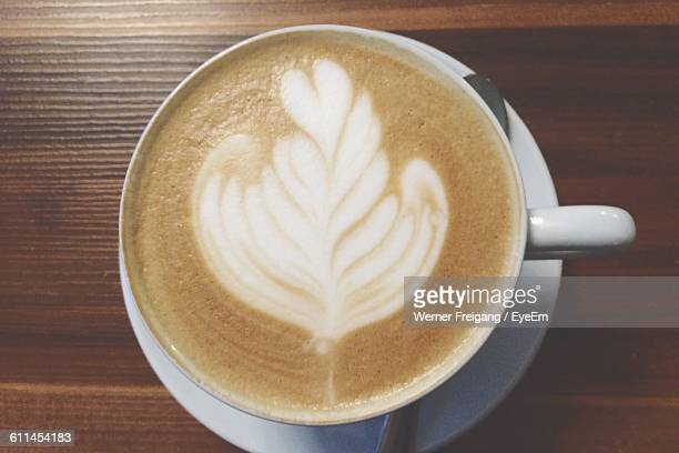 High Angle View Of Coffee In Cup On Wooden Table