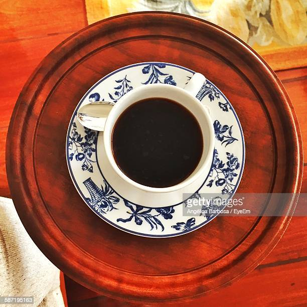 High Angle View Of Coffee On Plate At Table