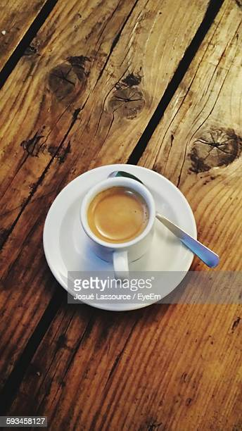 High Angle View Of Coffee Served On Wooden Table