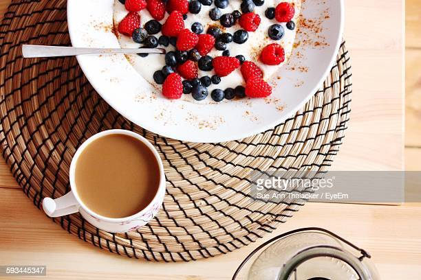High Angle View Of Coffee With Berry Fruits For Breakfast On Table