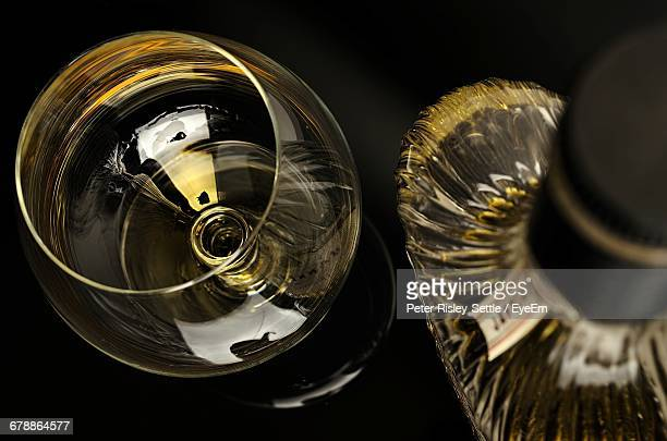 High Angle View Of Cognac In Snifter And Bottle On Table