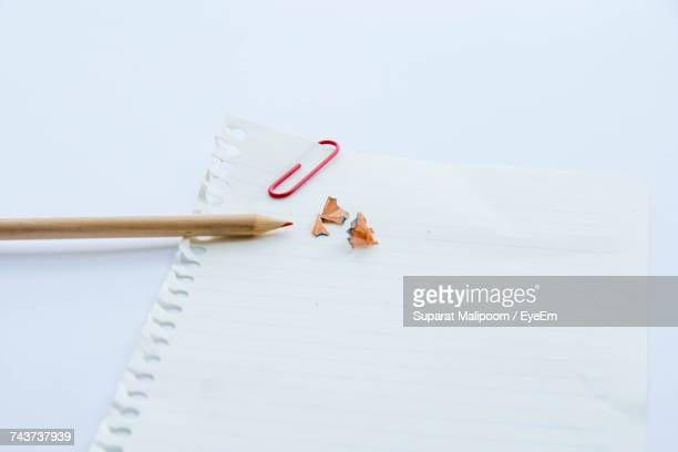 High Angle View Of Colored Pencil With Blank Paper On White Background