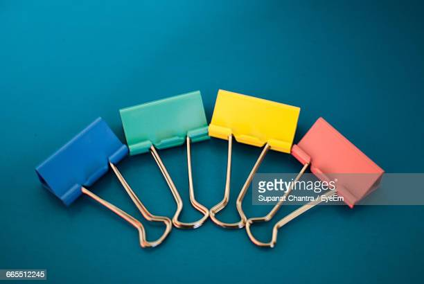 High Angle View Of Colorful Blinder Clips Arranged On Table