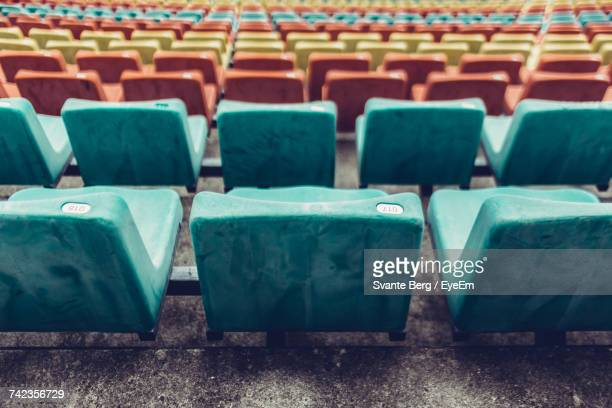 High Angle View Of Colorful Chairs At Stadium