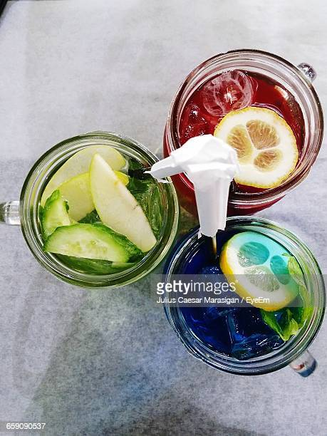 High Angle View Of Colorful Drinks On Table