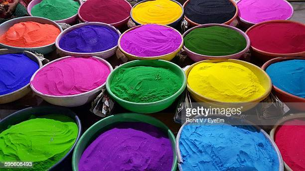 High Angle View Of Colorful Powder Paints In Bowls At Market Stall
