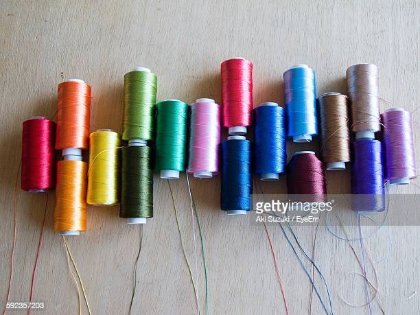 High Angle View Of Colorful Spools On Table