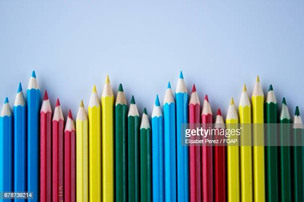 High angle view of coloured pencils