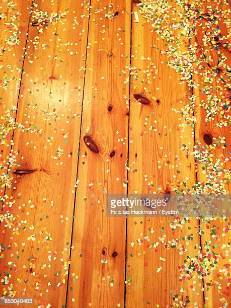 High Angle View Of Confetti On Floorboard