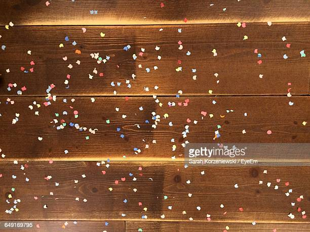 High Angle View Of Confetti On Wooden Flooring