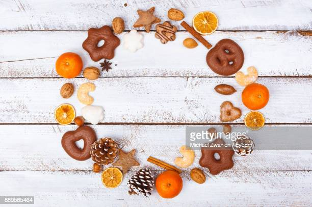 High Angle View Of Cookies And Fruits Arranging On Table
