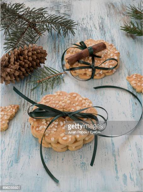 High Angle View Of Cookies Tied With Thread On Table During Christmas