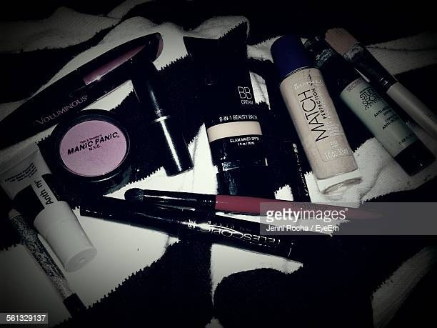 High Angle View Of Cosmetics On Fabric