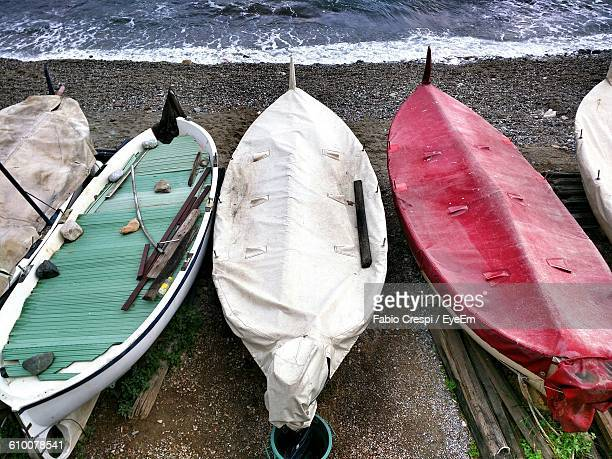 High Angle View Of Covered Boats At Sea Shore