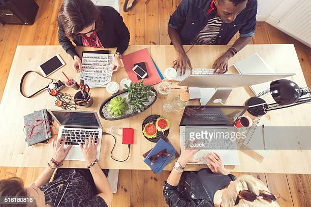 High angle view of creative people working at the table
