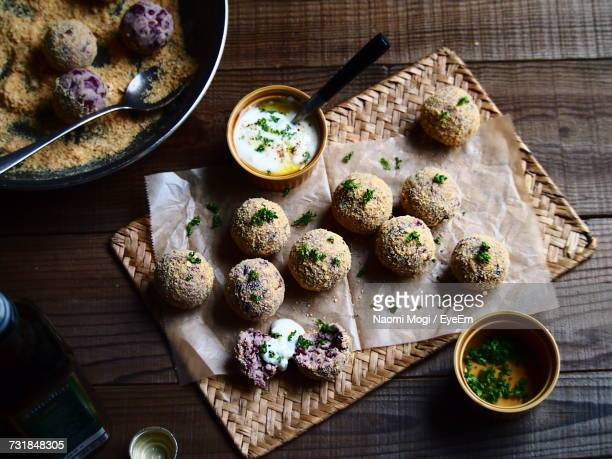 High Angle View Of Croquette On Place Mat Over Table