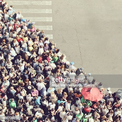 High Angle View Of Crowd Waiting At Crosswalk To Cross Road