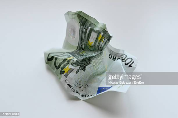 High Angle View Of Crumpled Hundred Euro Banknote