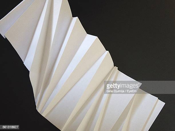 High Angle View Of Crumpled Paper Against Black Background