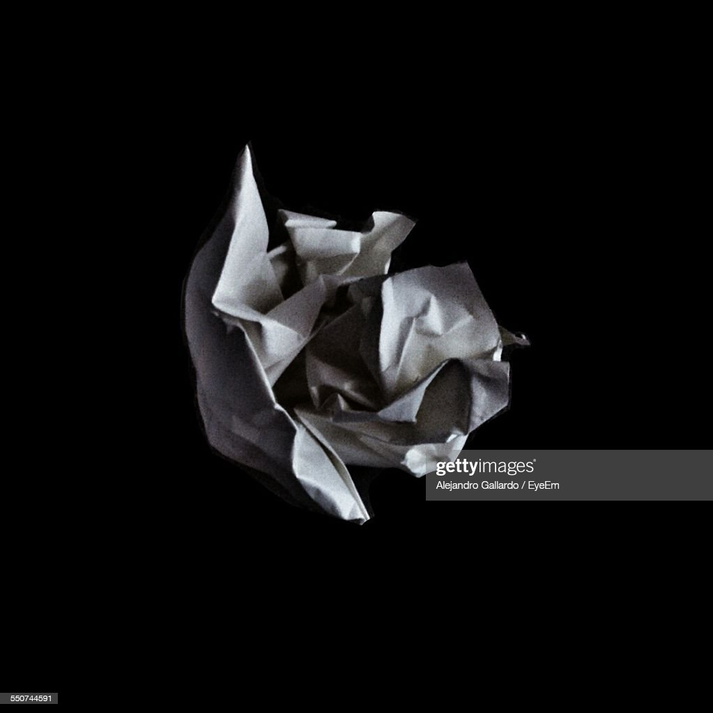High Angle View Of Crumpled Paper On Crumpled Paper