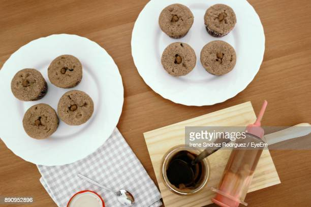 High Angle View Of Cupcakes On Wooden Table