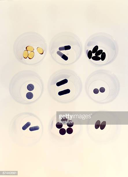 high angle view of cups holding assorted oral medication