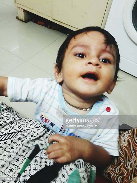 High Angle View Of Cute Baby Boy At Home