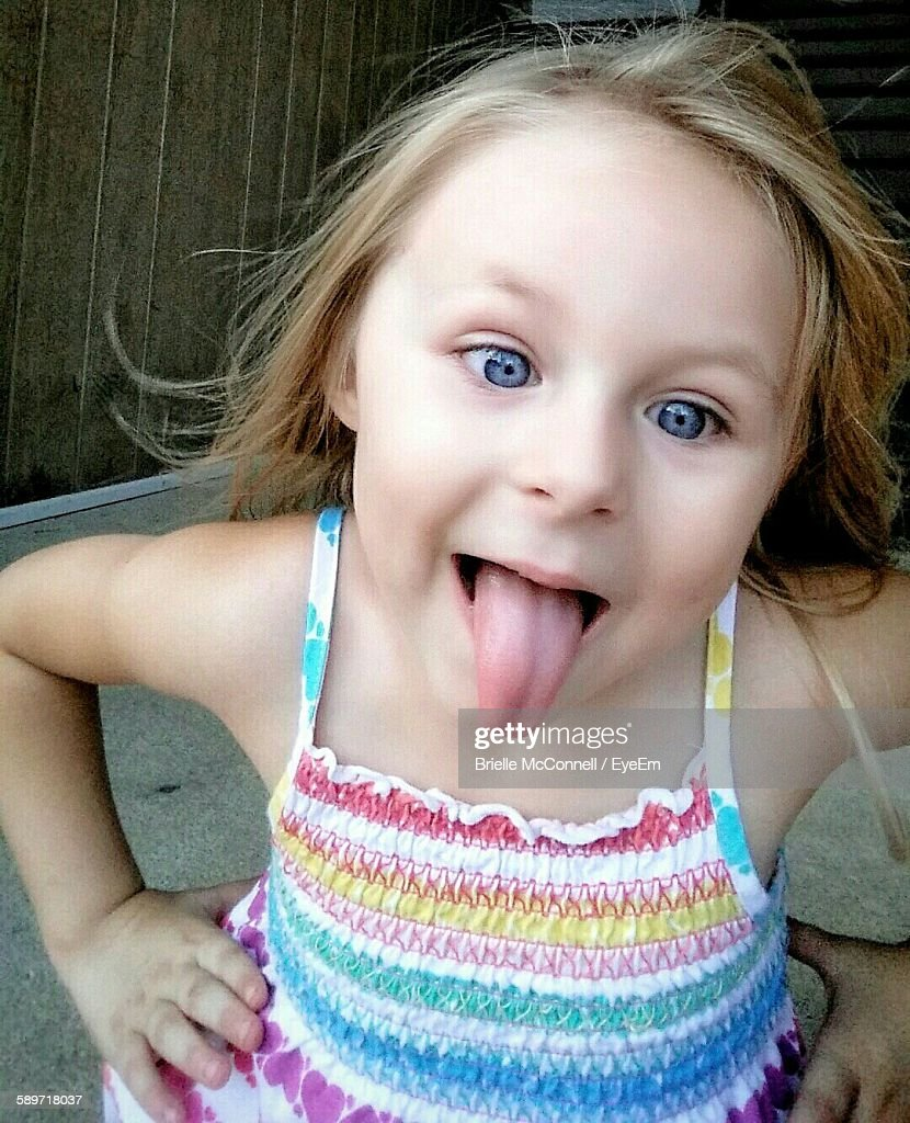 cute girl sticking her tongue out