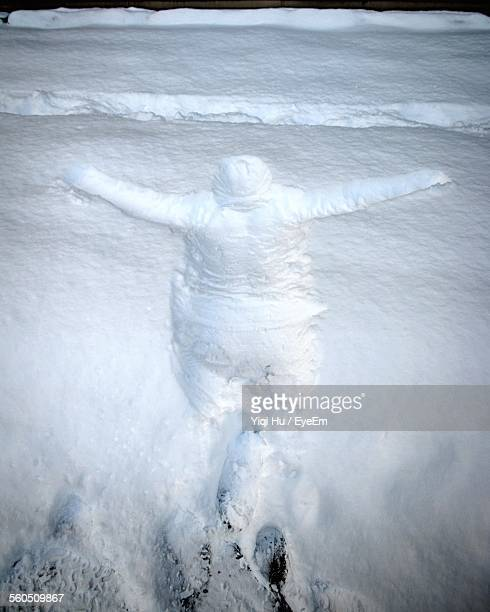 High Angle View Of Dead Person In Snow