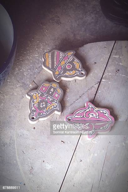 High Angle View Of Decorations On Wood