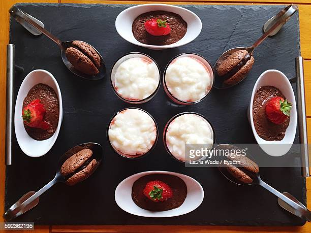 High Angle View Of Dessert And Rice Pudding Arranged On Serving Tray