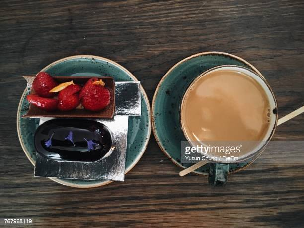 High Angle View Of Dessert With Coffee Cup On Table