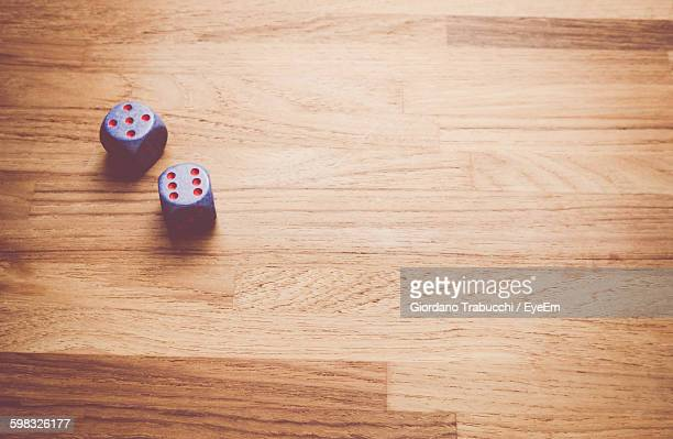 High Angle View Of Dices On Table