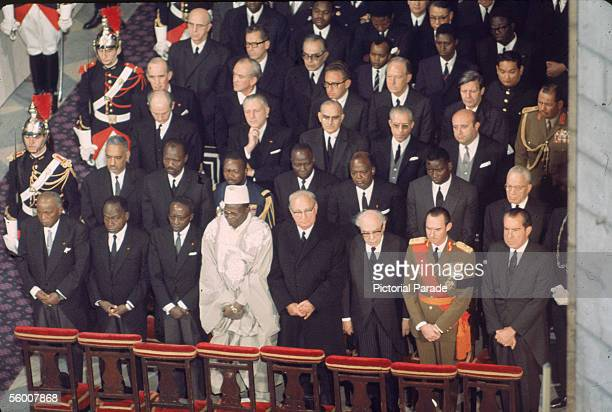 High angle view of dignitaries who stand in reverence during the memorial service for late former French President General Charles de Gaulle in Notre...